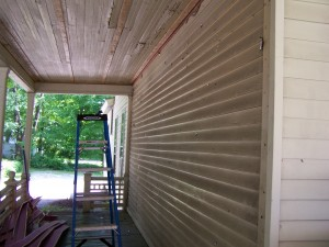 First side of aluminum siding removed.